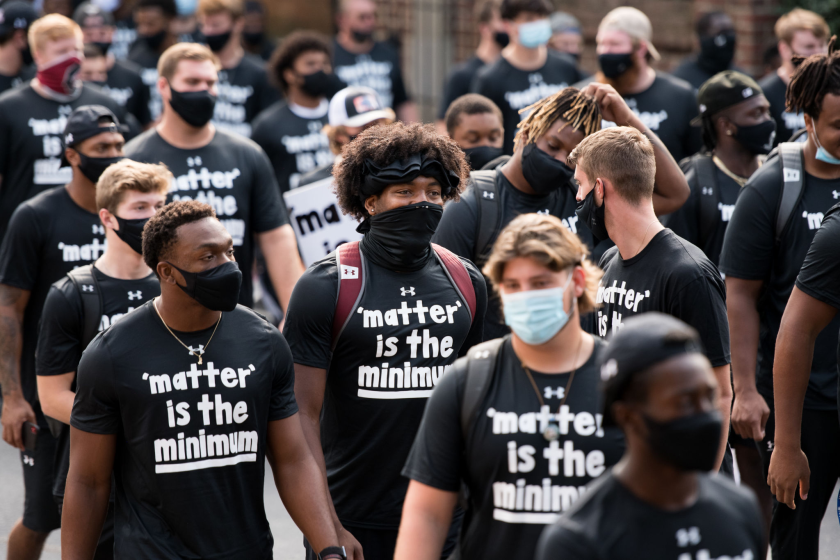 South Carolina football players participate in a demonstration against racial inequality and police brutality on Aug. 31.