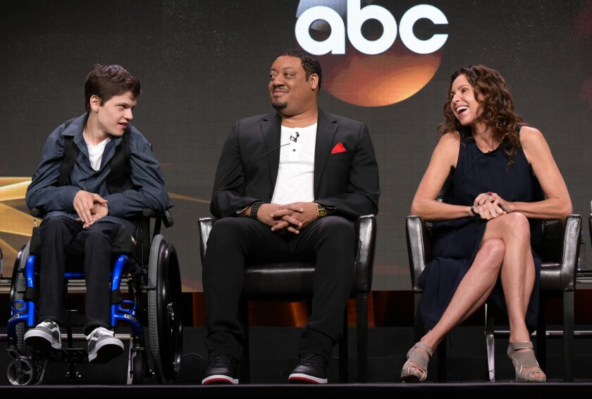 """Micah Fowler, left, Cedric Yarbrough and Minnie Driver participate in the """"Speechless"""" panel at the Television Critics Assn. summer press tour in Beverly Hills."""