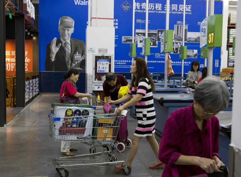 In this Monday, Nov. 9, 2015, photo, shoppers visit a Sam's Club in Shenzhen, China. Wal-Mart has 800 of the members-only stores worldwide, and four of the top 10 are in China. The No. 1 Sam's Club is in Shenzhen, a status it's enjoyed since 2008. (AP Photo/Ng Han Guan)