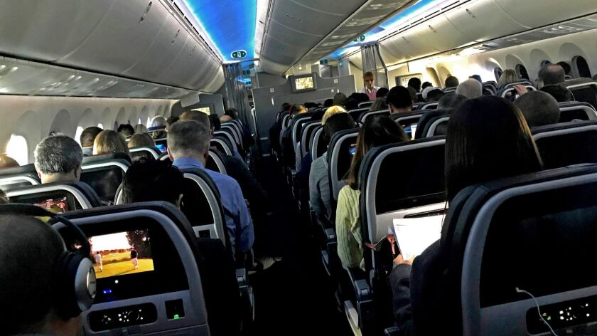 MAR. 5, 2018 - Main cabin passengers pass the time aboard American Airlines flight 2331, a Boeing 78