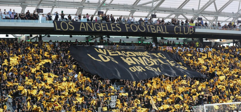 LAFC fans show their support before a match at Banc of California Stadium in July 2018.