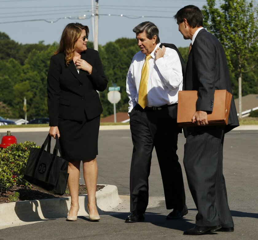 From left to right, Minda Riley Campbelll, former Alabama Gov. Bob Riley, Rob Riley walk to the Lee County Justice Center on Friday, June 3, 2016  in Opelika, Ala. Testimony resumes Friday in the ethics trial of Alabama House Speaker Mike Hubbard. (Todd J. Van Emst/Opelika-Auburn News via AP, Pool)