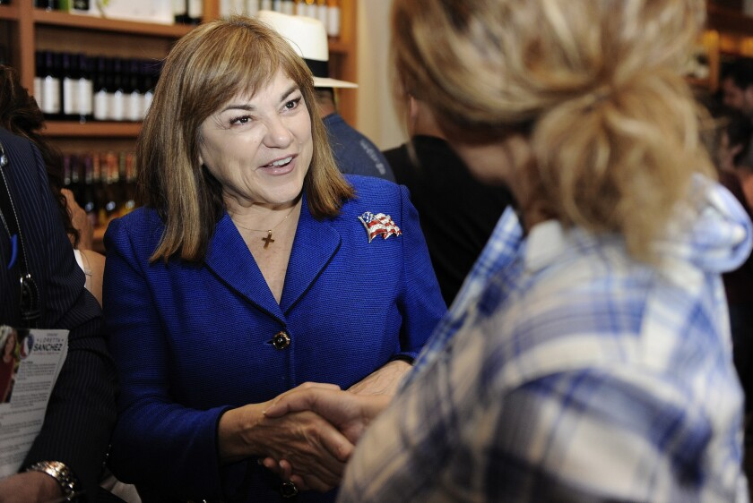 U.S. Senate candidate Loretta Sanchez talks with potential voters at San Antonio Winery on Sunday.