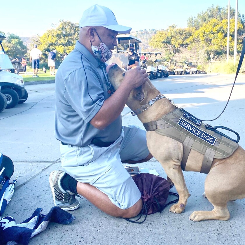 Lito Bautista (US Navy Ret.) with STS Service Dog Halia
