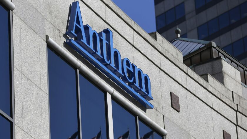 FILE - In this Feb. 5, 2015, file photo, the Anthem logo hangs at the health insurer's corporate hea