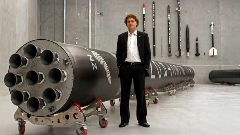 Peter Beck, Rocket Lab founder, with the Electron rocket.