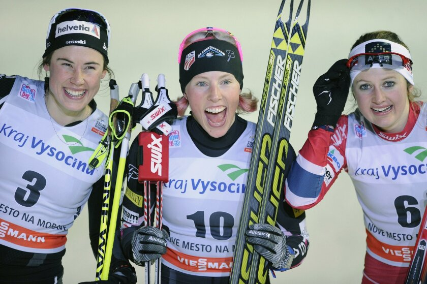 Second placed Laurien van der Graaff from Switzerland, winner Kikkan Randall from the USA and third placed Ingvild Flugstad Oestberg from Norway, from left to right, smile after their World Cup cross-country skiing sprint in Nove Mesto na Morave, Czech Republic, Saturday, Jan. 11, 2014. (AP Photo,CTK/Lubos Pavlicek) SLOVAKIA OUT