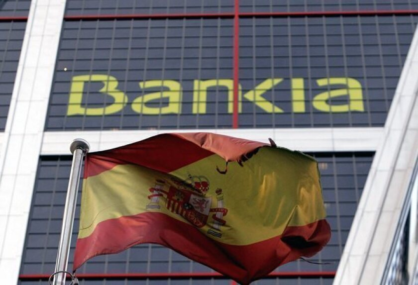 A Spanish flag flies next to Bankia headquarters in Madrid.