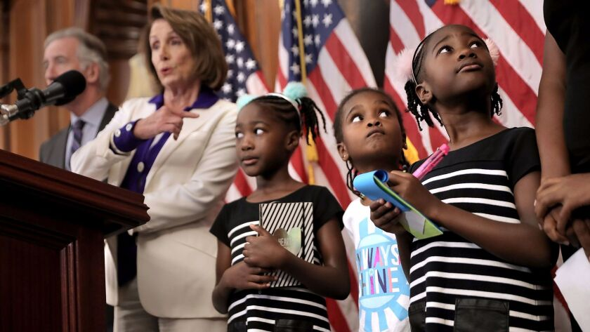 Twins Shiloh and Seilah Tappin and their friend Dani Hebron, all 7 years old, attend a news conference about CHIP and the ACA in Washington on Nov. 3.