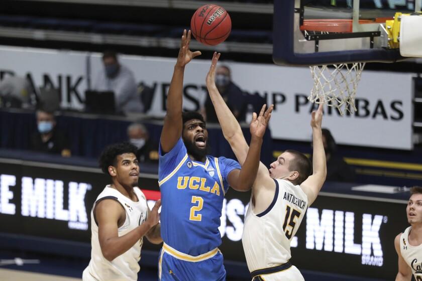 UCLA forward Cody Riley shoots against California forward Grant Anticevich during the first half.