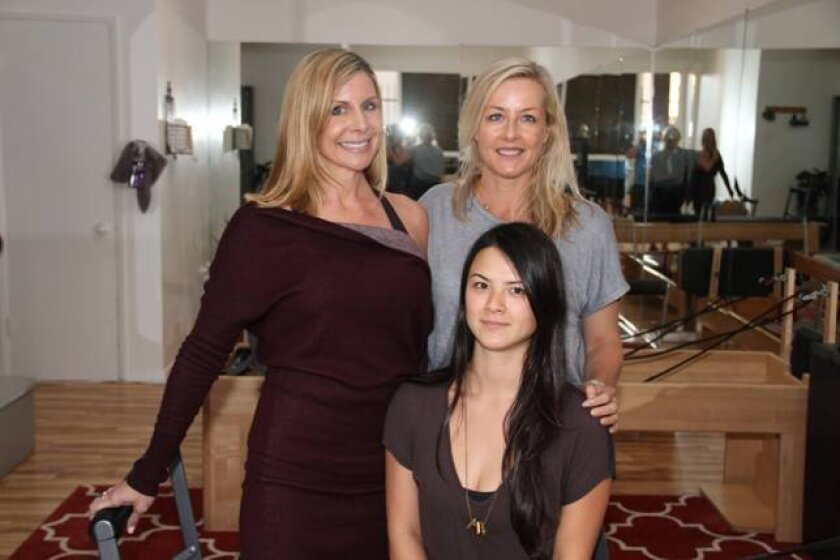 Aly's Pilates owner Alyssa Ramos (rear left) Jessica Weinas and Natalie Pierce (front). The private, full-service pilates studio is at 7448 Girard Ave.
