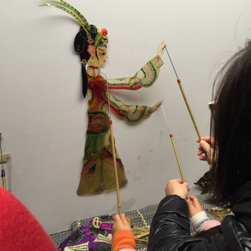 After every performance, spectators are invited backstage to try their hands at manipulating the sha