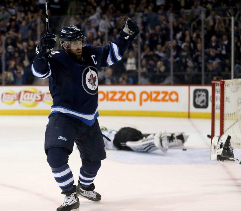 Winnipeg's Andrew Ladd celebrates a short-handed goal against Dallas goaltender Antti Niemi on Tuesday.