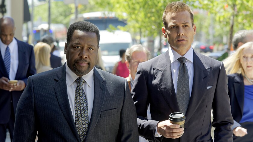 """Wendell Pierce, left, and Gabriel Macht in a new episode of """"Suits"""" on USA."""