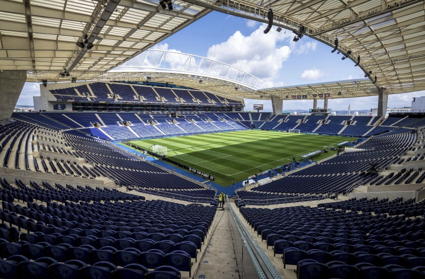 FILE - In this Tuesday, June 4, 2019 file photo, a general view of the Dragao stadium in Porto, Portugal. The path has been cleared for Porto to stage the Champions League final between Chelsea and Manchester City after Portuguese authorities approved the return of supporters to stadiums. UEFA is planning to announce by the end of the week that the 50,000-capacity Estádio do Dragão will be used for the May 29 showpiece with thousands of fans from both English clubs set to be allowed into the game. (AP Photo/Luis Vieira, File)