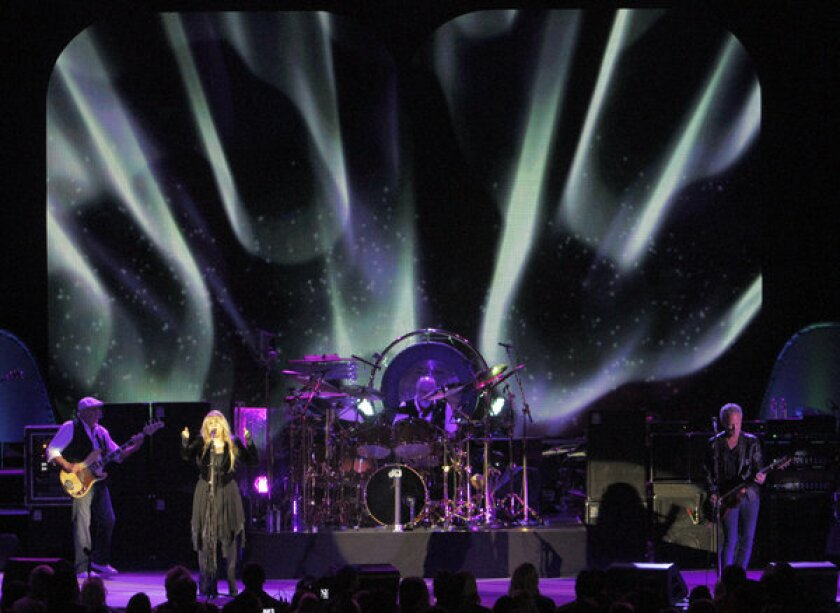 Fleetwood Mac's John McVie, left, Stevie Nicks, Mick Fleetwood and Lindsey Buckingham perform at the Hollywood Bowl on May 25, 2013.