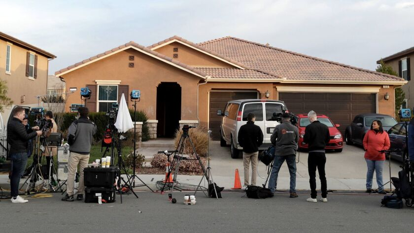 Members of the media camp out in front of the Perris home of David and Louise Turpin, Tuesday morning January 16, 2018. The couple were arrested on suspicion of torture and child endangerment after their 12 children were found shackled and malnourished.