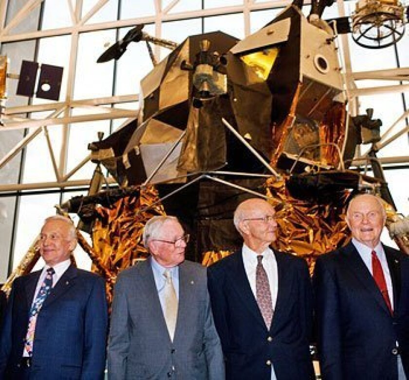 Apollo 11 crew (from left) Buzz Aldrin, Neil Armstrong and Michael Collins were joined by John Glenn last night at the National Air and Space Museum.  (The Washington Post)