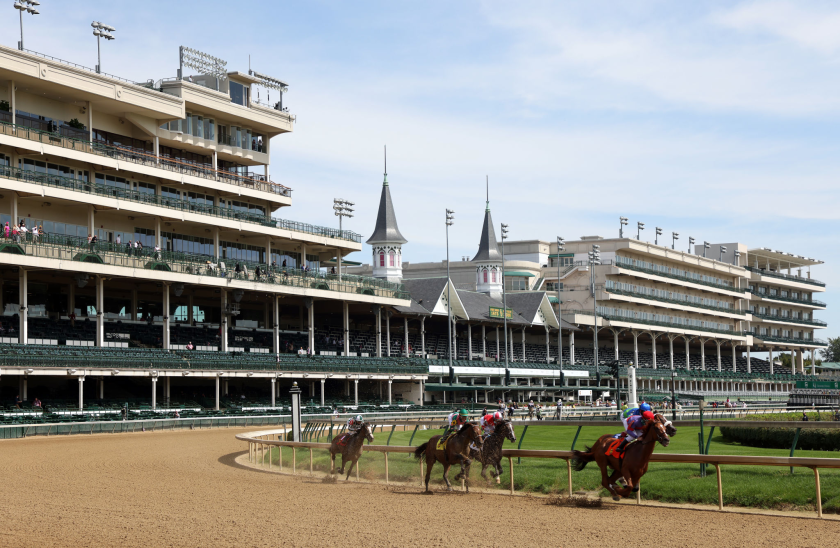 A general view of empty grandstands as horses run at Churchill Downs