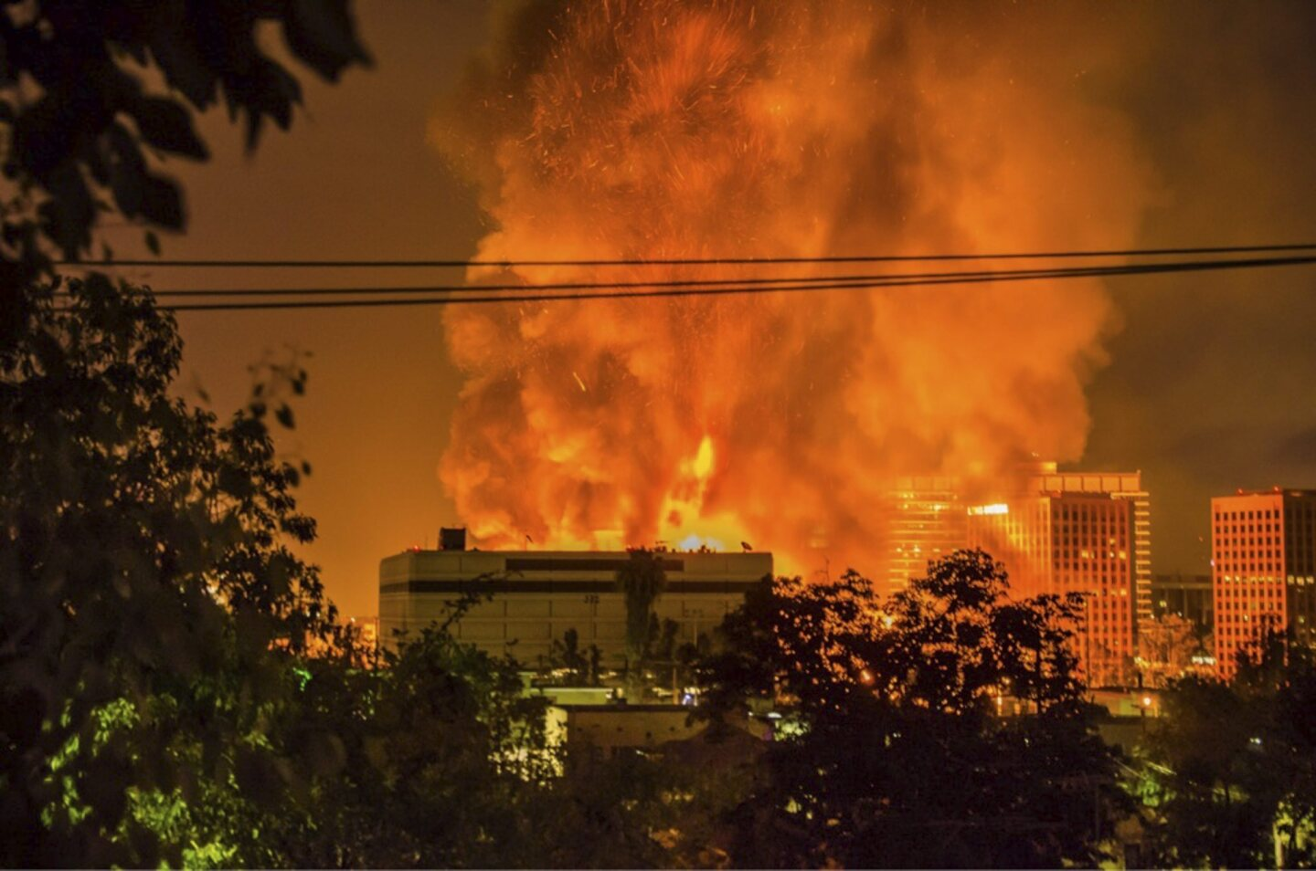 More than 200 firefighters work to control a massive fire as it destroys a seven-story building under construction in downtown Los Angeles.