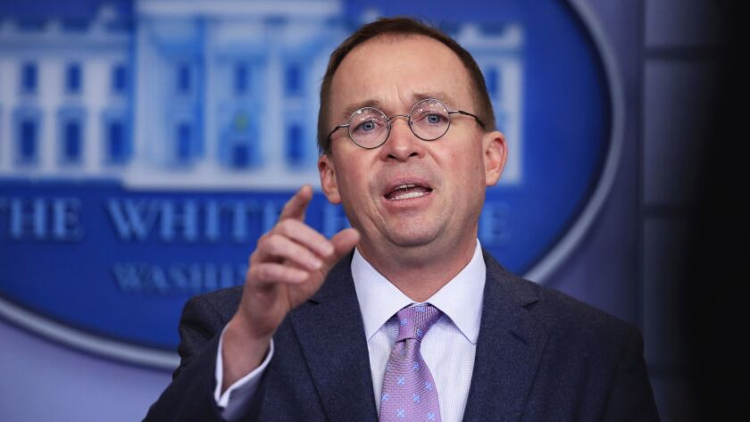 Office of Management and Budget Director Mick Mulvaney, shown at the White House in March, has given big pay raises to the deputies he has hired at the Consumer Financial Protection Bureau.