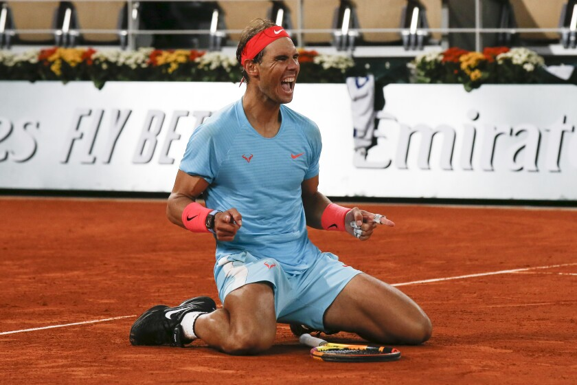Rafael Nadal celebrates winning the final match of the French Open.