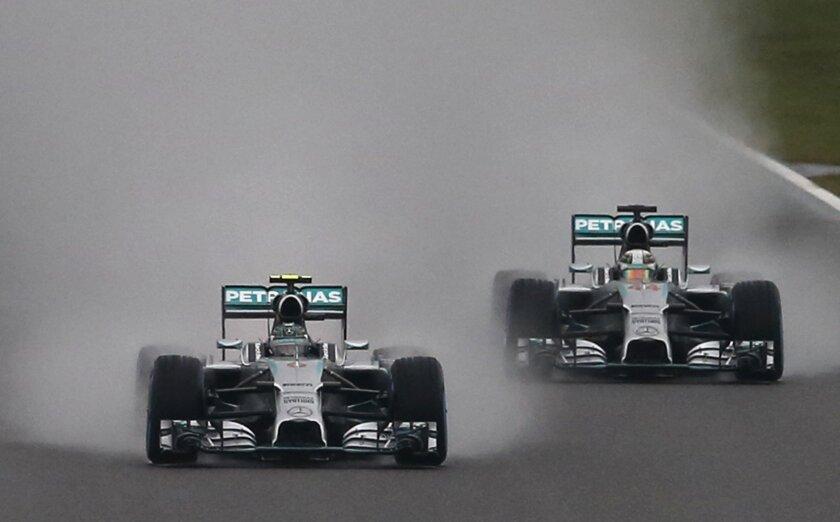 Mercedes driver Nico Rosberg of Germany, left, leads Mercedes driver Lewis Hamilton of Britain at Japanese Formula One Grand Prix at the Suzuka Circuit in Suzuka, central Japan, Sunday, Oct. 5, 2014.(AP Photo/Shuji Kajiyama)