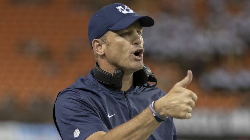 FILE - In this Nov. 3, 2018, file photo, Utah State coach Matt Wells gestures to officials during th