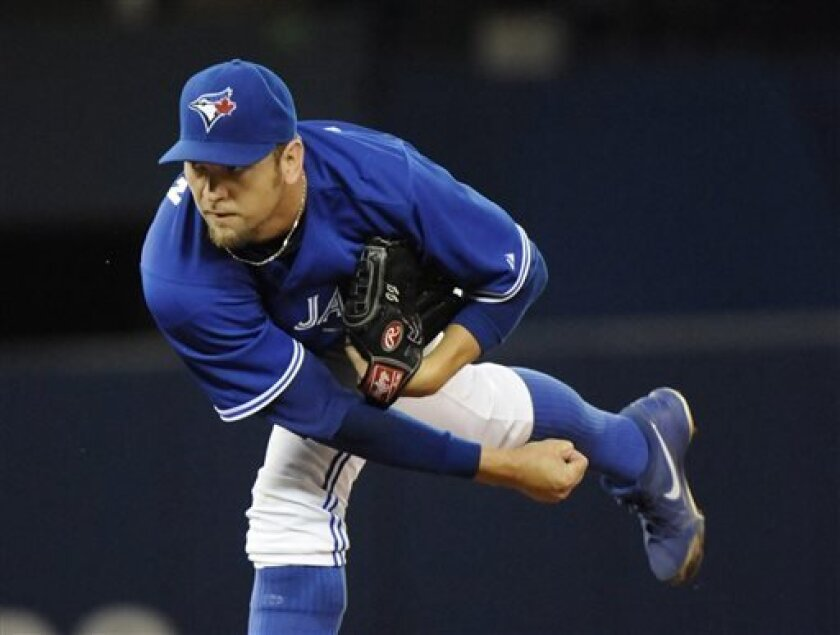 Toronto Blue Jays' Josh Johnson pitches against the Houston Astros during first inning of a baseball Saturday, July 27, 2013, in Toronto. (AP Photo/The Canadian Press, Jon Blacker)
