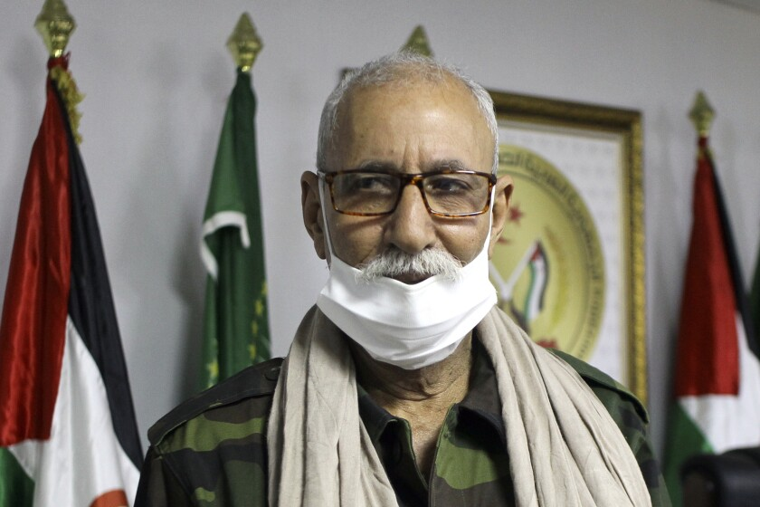 FILE - In this Feb.26, 2021 file photo, Brahim Ghali, the leader of the Polisario Front and the self-declared Sahrawi Democratic Arab Republic poses in the refugee camp of Tindouf, southern Algeria. A Spanish judge on Thursday July 29, 2021 has thrown out a lawsuit against Ghali that accused him of torture, genocide and other crimes saying that the 20-year statute of limitations had expired for the alleged crimes. (AP Photo/Fateh Guidoum, File)