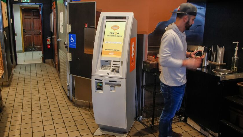 SAN DIEGO, CA January 9th, 2018 | John Gil prepares his coffee next to a Bitcoin ATM machine at Lest