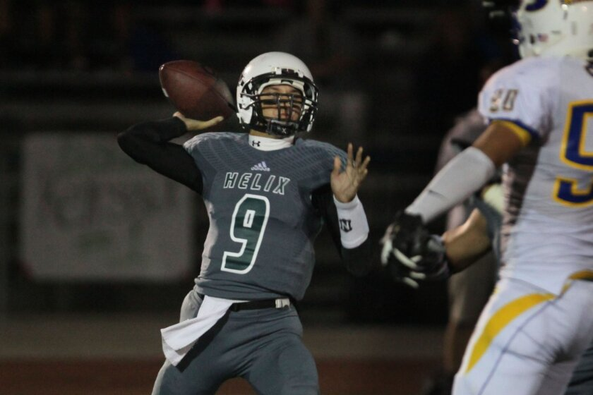 Helix quarterback Michael Austin (shown in a game earlier this season) threw two touchdown passes in the Highlanders' win over Cathedral on Friday.