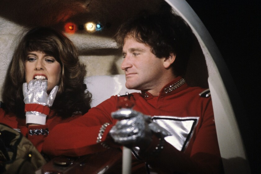 "Robin Williams became a star in his first lead role on TV as the alien Mork in ""Mork & Mindy"" with Pam Dawber."