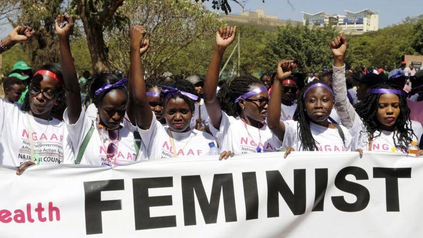 Kenyan women shout slogans during a march to mark International Women's Day in Nairobi, Kenya, Frida