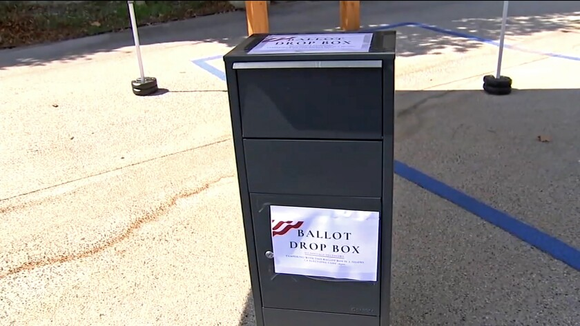 This photo from video provided by ABC7 Los Angeles shows an unofficial ballot drop box at Grace Baptist Church in Santa Clarita, Calif., in October, 2020. California's ballot harvesting law is creating controversy this election year. The law allows for people to collect ballots from voters and return them to county election offices. Republicans have set up unofficial drop boxes in some counties with closely contested U.S. House races. State officials say the boxes are illegal and have ordered the party to remove them. But party leaders say they are using the boxes to collect ballots as the law allows. At least one Democratic campaign has designated volunteers who receive ballots at their homes from voters who want help in returning them. (ABC7 Los Angeles via AP)