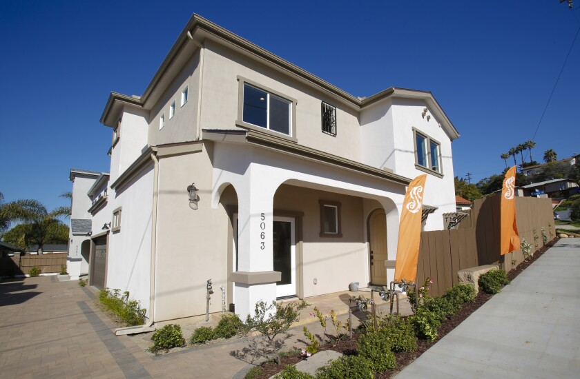 This newly built home on Savannah Street in the Bay Park area of San Diego has a two-level living area of 1,918 square feet. It has three bedrooms (optional fourth using the loft), three bathrooms and a rooftop deck of 262 square feet.