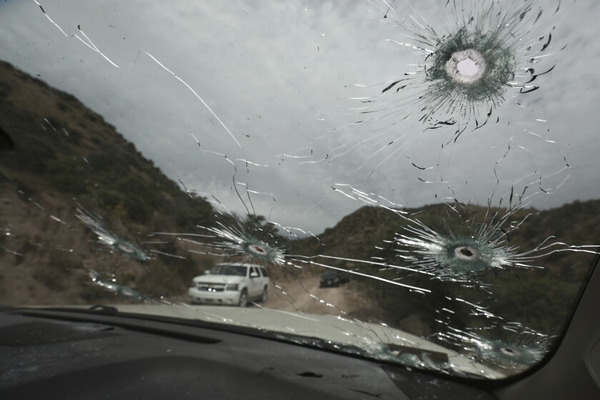 Bullet-riddled vehicles that members of the extended LeBaron family were traveling in sit parked on a dirt road near Bavispe, at the Sonora-Chihuahua state border, Mexico, Wednesday, Nov. 6, 2019. Three women and six of their children, related to the extended LeBaron family, were gunned down in an attack while traveling here Monday. (AP Photo/Christian Chavez)