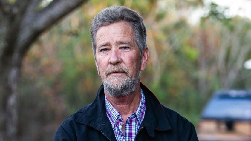 Leslie McCrae Dowless Jr. stands outside his home in Bladenboro, N.C., this month. North Carolina officials sought criminal charges against him after the 2016 election. He's now at the center of fraud allegations in a 2018 congressional race.