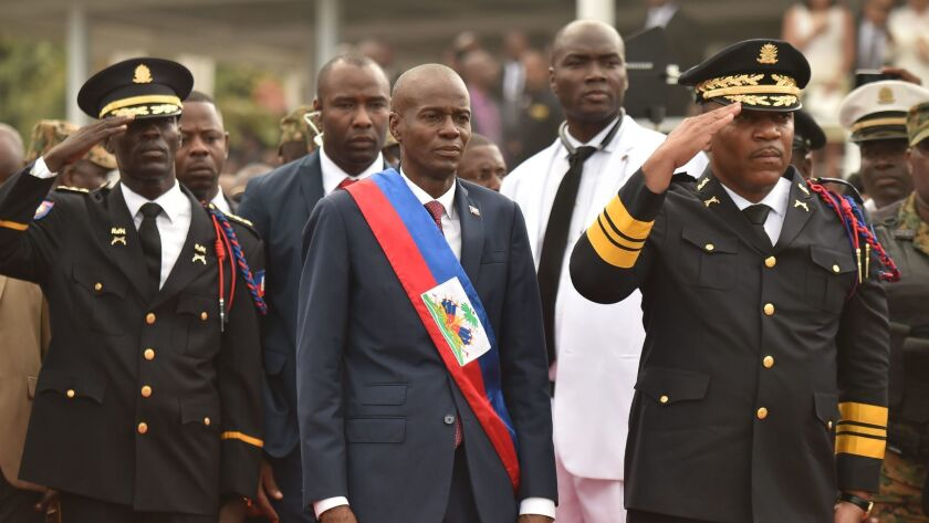 Haitian President Jovenel Moise reviews the troops during his inauguration ceremony at the National