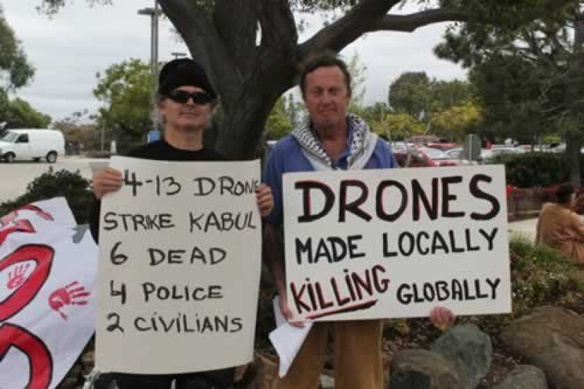 Many signs at the anti-drone protest advocate stopping the use of drones. Ashley Mackin