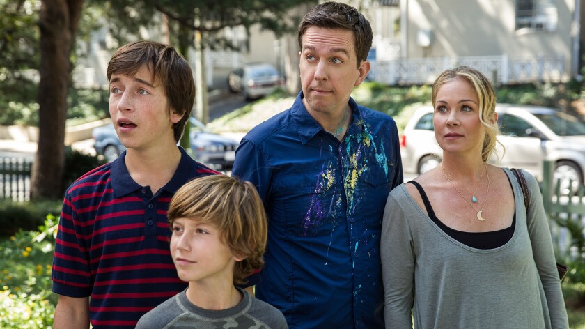 "Skyler Gisondo as James Griswold, Steele Stebbins as Kevin Griswold, Ed Helms as Rusty Griswold and Christina Applegate as Debbie Griswold in New Line Cinema's comedy movie ""Vacation."""