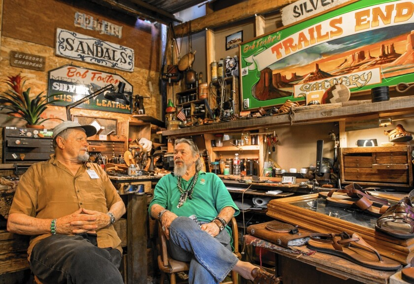 Dion Wright and Bob Foster sit in Foster's booth reminiscing about Sawdust Festivals gone by.