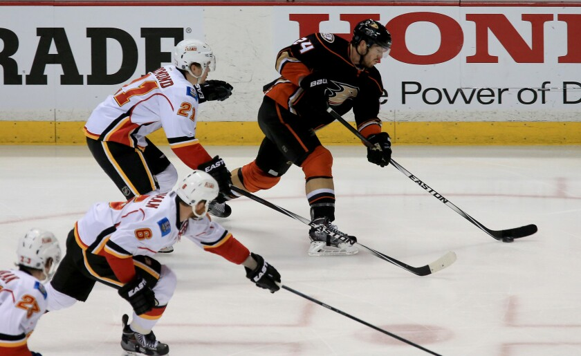 Ducks defenseman Simon Despres gets off a shot against the Flames in the second period of Game 2.