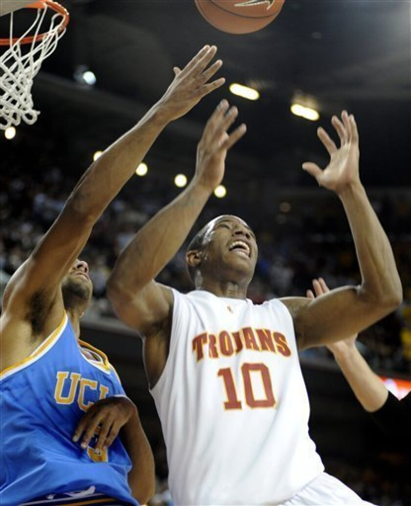The University of Southern California's DeMar DeRozan goes up for a rebound against UCLA's Josh Shipp during the second half of an NCAA men's basketball game in Los Angeles on Sunday, Jan. 11, 2009. UCLA won 64-60. (AP Photo/David Zentz)