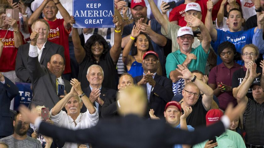 Supporters of President Donald Trump cheer him after his speech at a campaign rally at the Ford Center on Aug. 30, in Evansville, Ind.