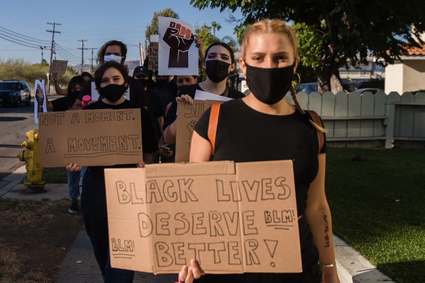 Protesters march against racism in El Cajon on September 26, 2020.