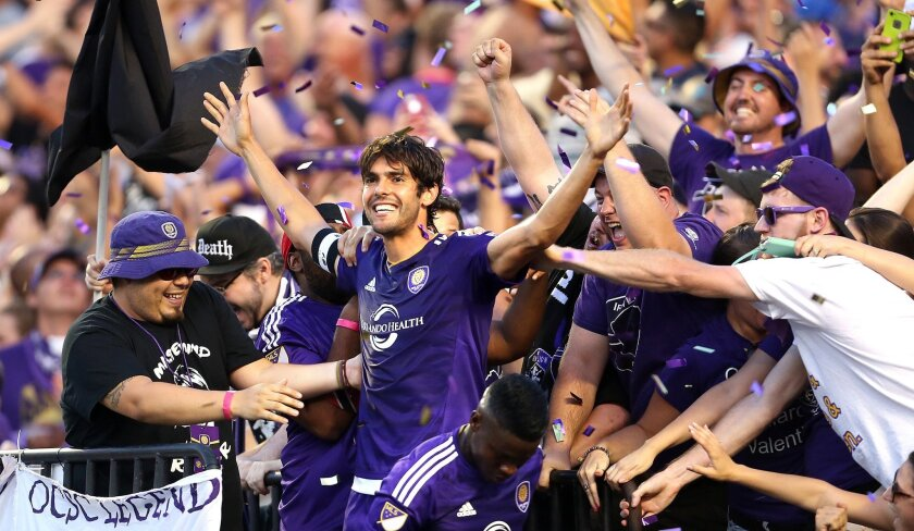 Orlando City's Kaka celebrates in the stands after scoring the first goal against the Columbus Crew during the first half of an MLS soccer game Saturday, May 30, 2015, in Orlando, Fla. (Stephen M. Dowell/Orlando Sentinel via AP) MAGS OUT; NO SALES