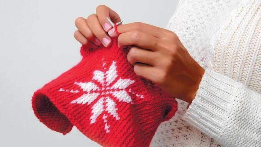 """Creative Yarn and Girlfriend Therapy Group meets once a month at members' homes where girlfriends bring dishes to share for lunch and """"show and tell"""" about their monthly creations."""