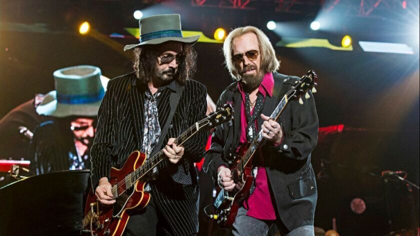 Mike Campbell (left) and Tom Petty trade guitar licks Sunday at KAABOO Del Mar.