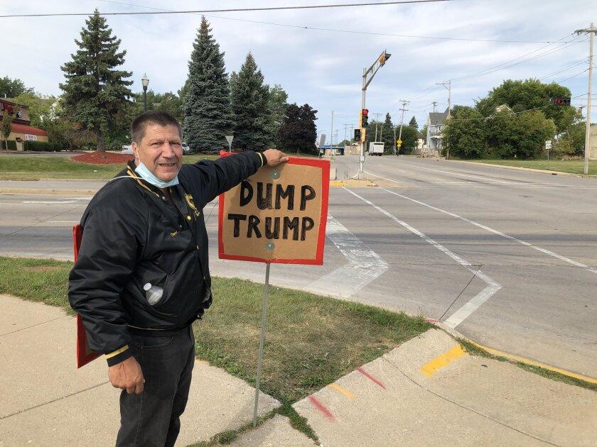 David Swartz, 56, protests President Trump's visit to Kenosha, Wis.